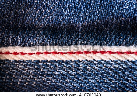 Texture of denim blue delimited by the red.