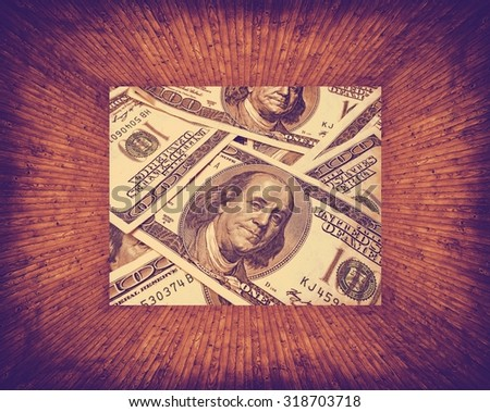texture of dollars placed in a wooden frame - stock photo