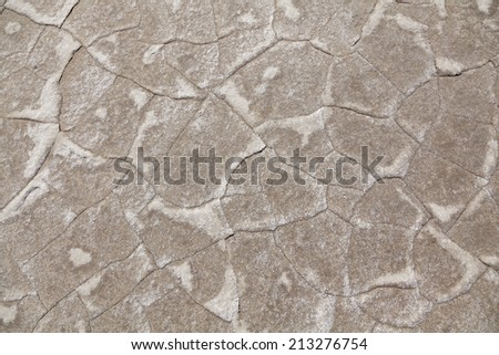 texture of dried earth, photographed during the day in the desert. - stock photo