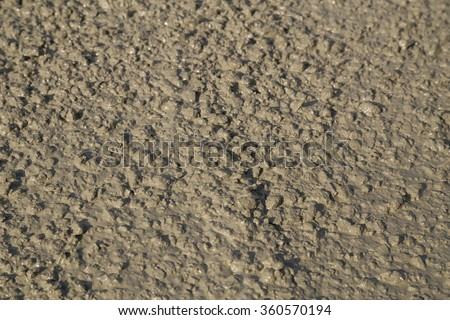 Texture of fresh mortar. Wet cement at construction site - stock photo
