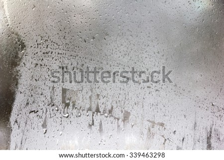 Texture of frozen drops on frosted glass. Winter textured background. - stock photo