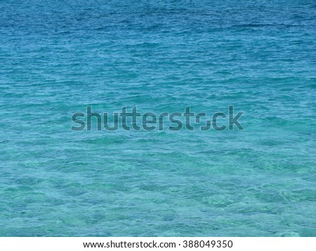 Texture of gradient sea water surface going from azure to darker blue in color. Ideal as a background. - stock photo