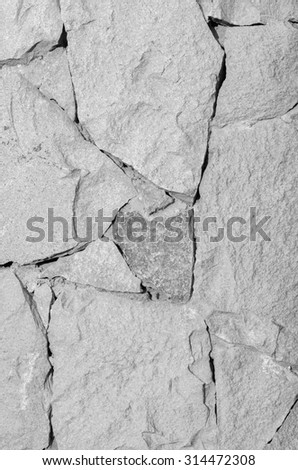 Texture of gray stone fit together. Black and white textured composition - stock photo