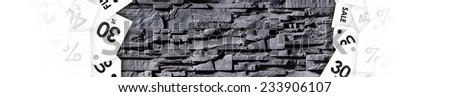 Texture of grey stonewall with discount labels. Concept of savings