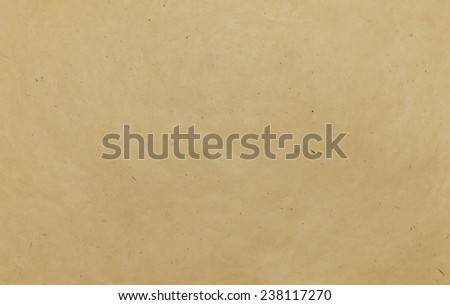 Texture of handmade beige paper sheet as background - stock photo