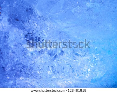 Texture of ice  with blue back light. Abstract background. - stock photo