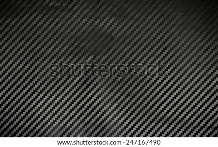 Texture of Kevlar Carbon Fiber material. Dark background - stock photo