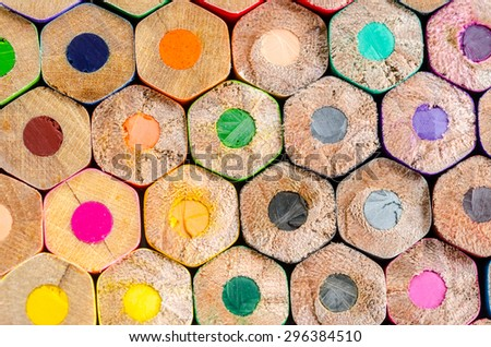 Texture of many wooden colored pencils