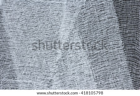texture of medical bandage on a dark background - stock photo