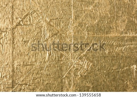 texture of old crumpled gold foil - stock photo