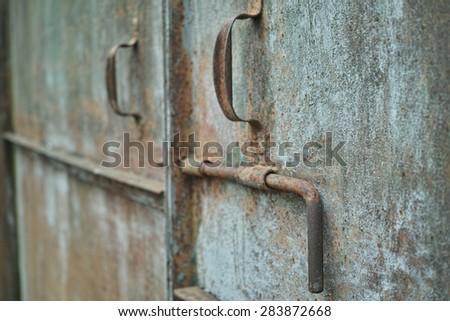 Texture of  old damaged metal door - stock photo