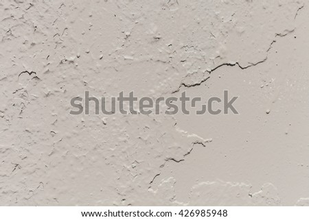 Texture of old painted gray wall. Peeling paint on the worn metal or concrete wall with cracks. Battered and ruined destroyed grey surface side - stock photo