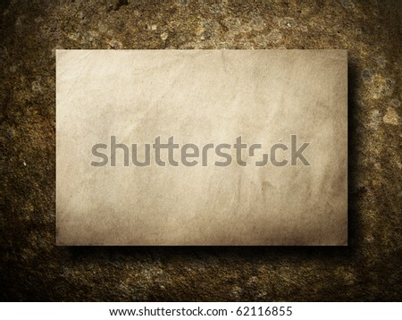 Texture of old paper on brown stone background