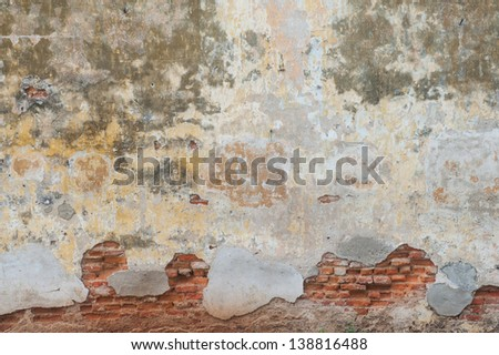 Texture of old plastered wall with bricks - stock photo