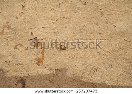 Texture of old rustic wall covered with gray stucco