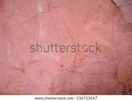 Texture of old rustic wall covered with pink stucco
