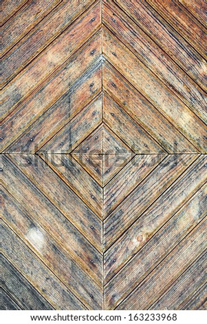 Texture of old stained wooden door - stock photo