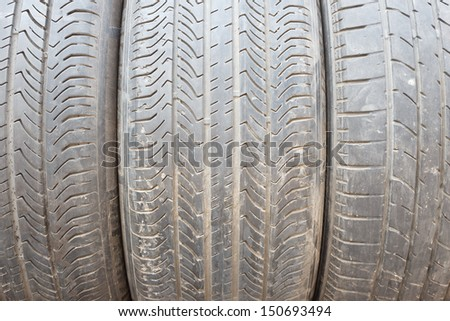 Texture of old three tire layer and old tire blackground - stock photo
