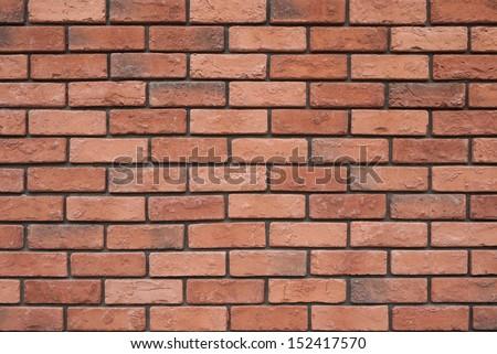 Texture of orange brick wall - stock photo