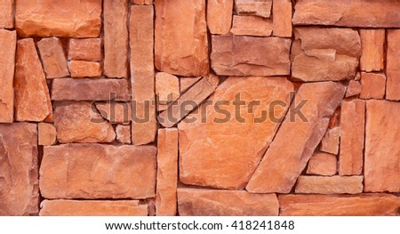 Texture of Orange Stone brick wall for background