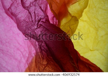 Texture of orange-yellow and pink striped crumpled paper for pattern background