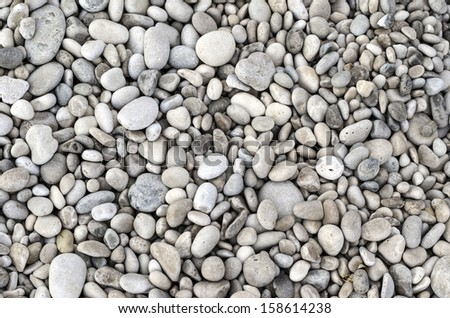 Texture of pebbles from a beach shore. - stock photo
