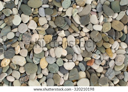 Texture of pebbles from a beach shore - stock photo
