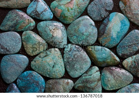 Texture of polished wet turquoise gemstones. - stock photo