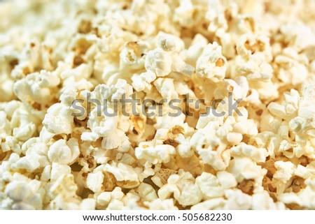 Texture of popcorn with salt close-up. Basic bright heaven background for design