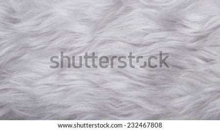 texture of red velvet and white artificial fur - stock photo