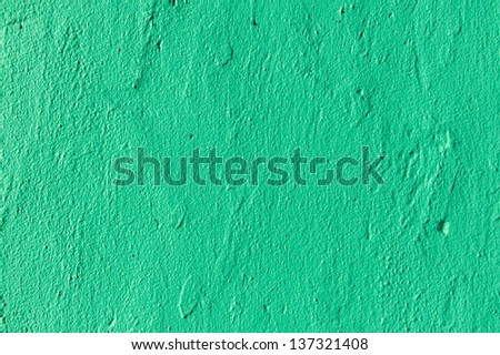Texture of rough plastered green wall - stock photo