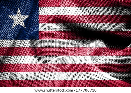 Texture of sackcloth with the image of the Liberia Flag  - stock photo