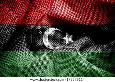 Texture of sackcloth with the image of the Libya flag