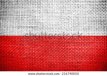 Texture of sackcloth with the image of the Poland flag  - stock photo