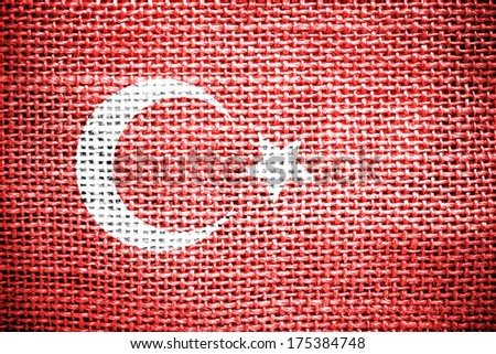Texture of sackcloth with the image of the Turrkey Flag  - stock photo