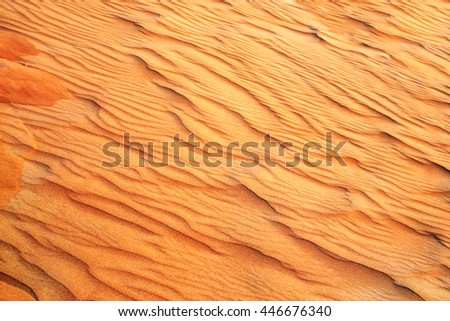 Texture of sand dune of orange color in desert, UAE
