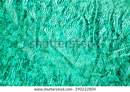 texture of silk fabric; background. green skin of the snake. shiny fabric - stock photo