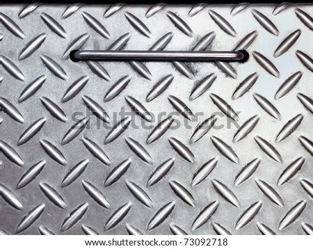 Texture of silver metal and handle - stock photo