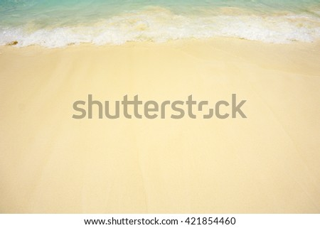 Texture of soft wave on the sand scenery beach at famous sea, Thailand.  - stock photo