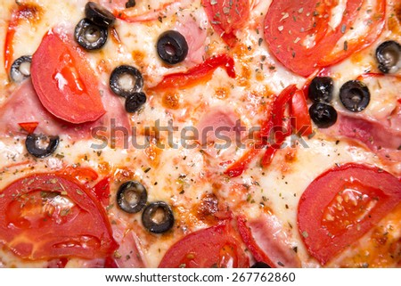 Texture of tasty Italian pizza with ham, tomatoes and olives, top view    - stock photo