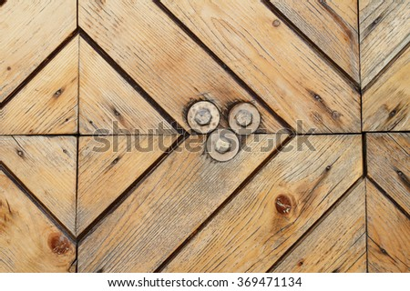 Texture of the boards are handmade. Wood background. Texture of old door, made by the monks of St. Nicholas monastery in Staraya Ladoga. The wooden door. Nails in the tree.