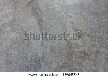 texture of the gray polished concrete wall with scratches for background - stock photo