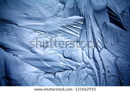 texture of the ice, cracks and sharp edges of the glass frozen water, frosty background - stock photo