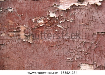 Texture of the old brown paint on a wooden fence/Old wooden planks with cracked paint