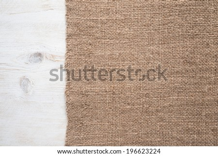 Texture of the old burlap and wood   - stock photo
