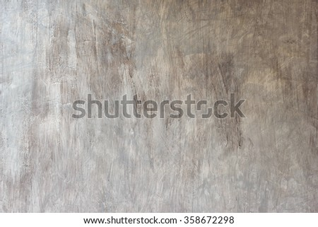 Texture of the polished concrete wall with scratches for background - stock photo