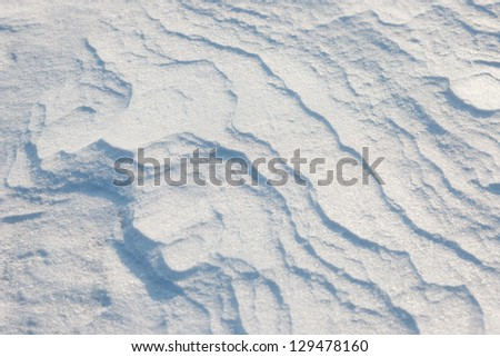texture of the snow cover on the beach on a sunny day - stock photo