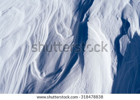 Texture of the snow drifts. Abstract background for design - stock photo
