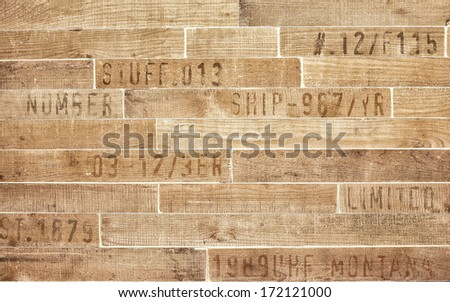 texture of vintage stamps on wooden planks - stock photo