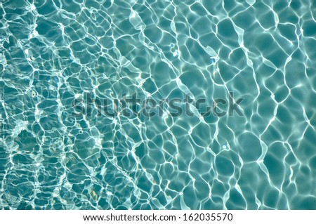 Texture of water and sunlight reflection in swimming pool. - stock photo